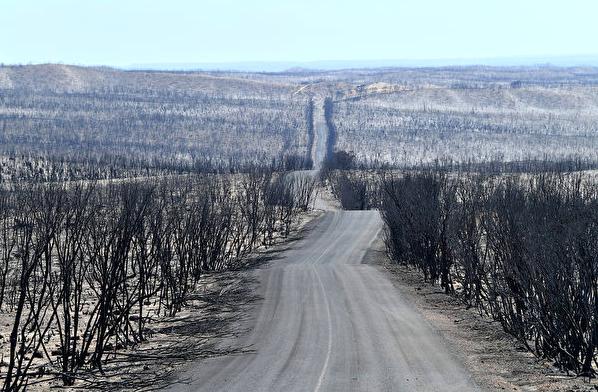 总理宣布援助1100万 帮南澳山火灾民重建
